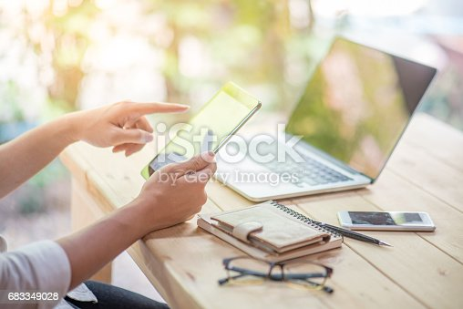istock Business man holding tablet and working with laptop and smart phone 683349028