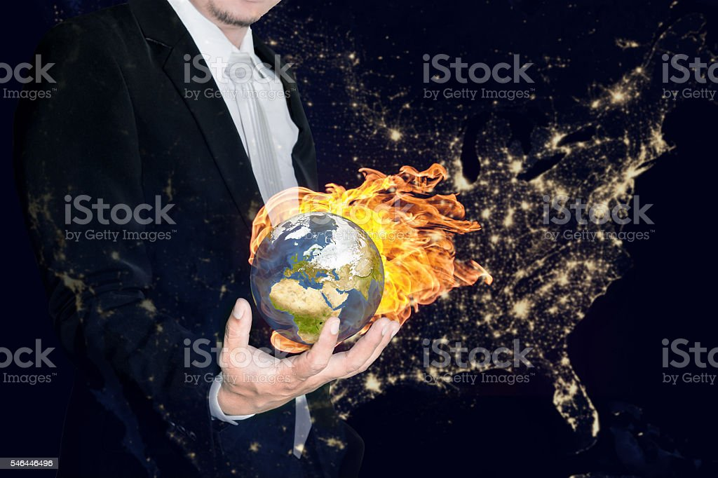 Technology Management Image: Business Man Holding The Burning Global Earth In His Hands