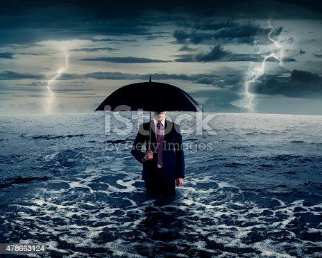 istock Business Man Holding Umbrella On The Sea 478663124