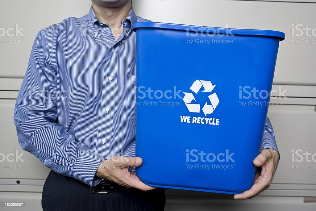 Business man holding up recycling bin royalty-free stock photo