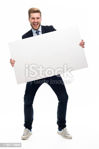 istock Business man holding white board 1135773956