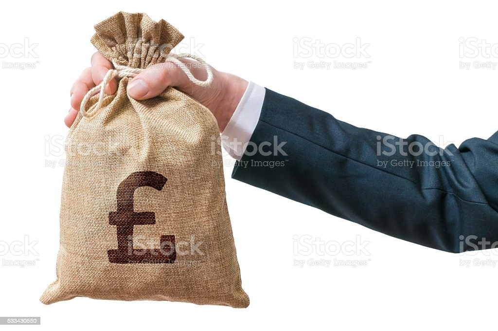 Business man holds bag full of money with British pounds. stock photo