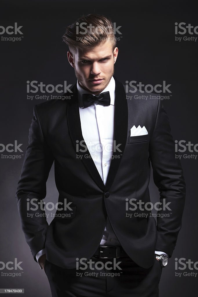 business man holds both hands in pockets stock photo