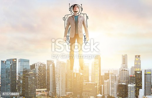 istock Business man hover over city skyline 675708634