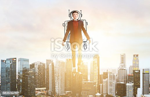 istock Business man hover over city skyline 683530752