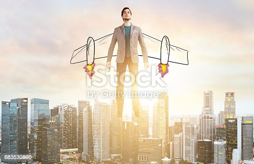 istock Business man hover over city skyline 683530860