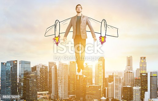 istock Business man hover over city skyline 683575212