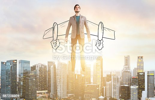 istock Business man hover over city skyline 687206924