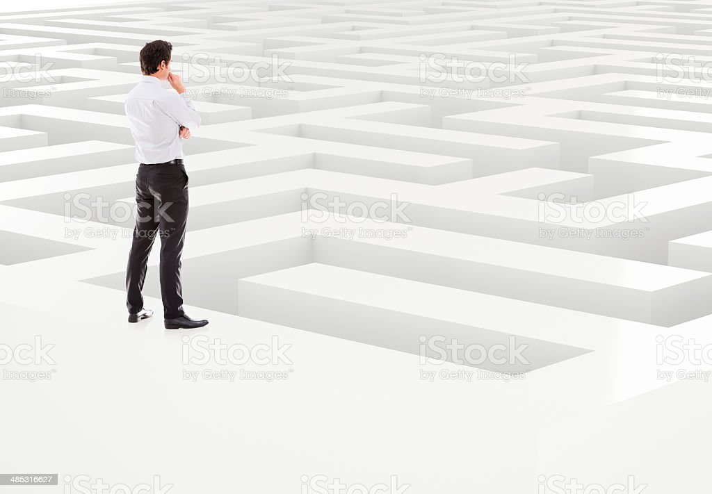 Business man in a maze stock photo