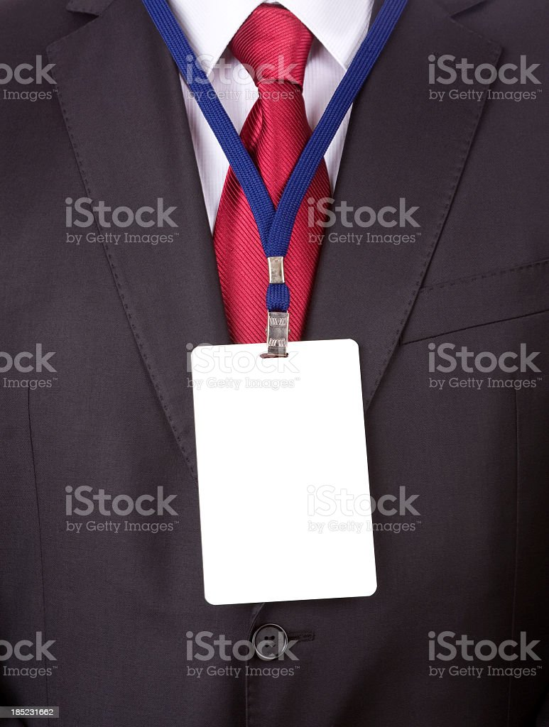 A business man in a suit and tie with a name tag lanyard stock photo