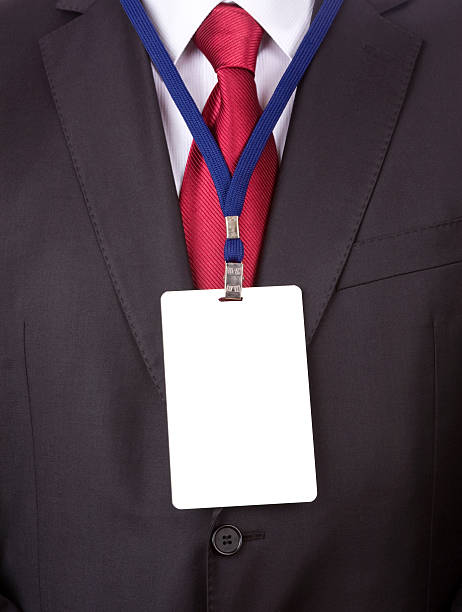 a business man in a suit and tie with a name tag lanyard - identity card stock photos and pictures