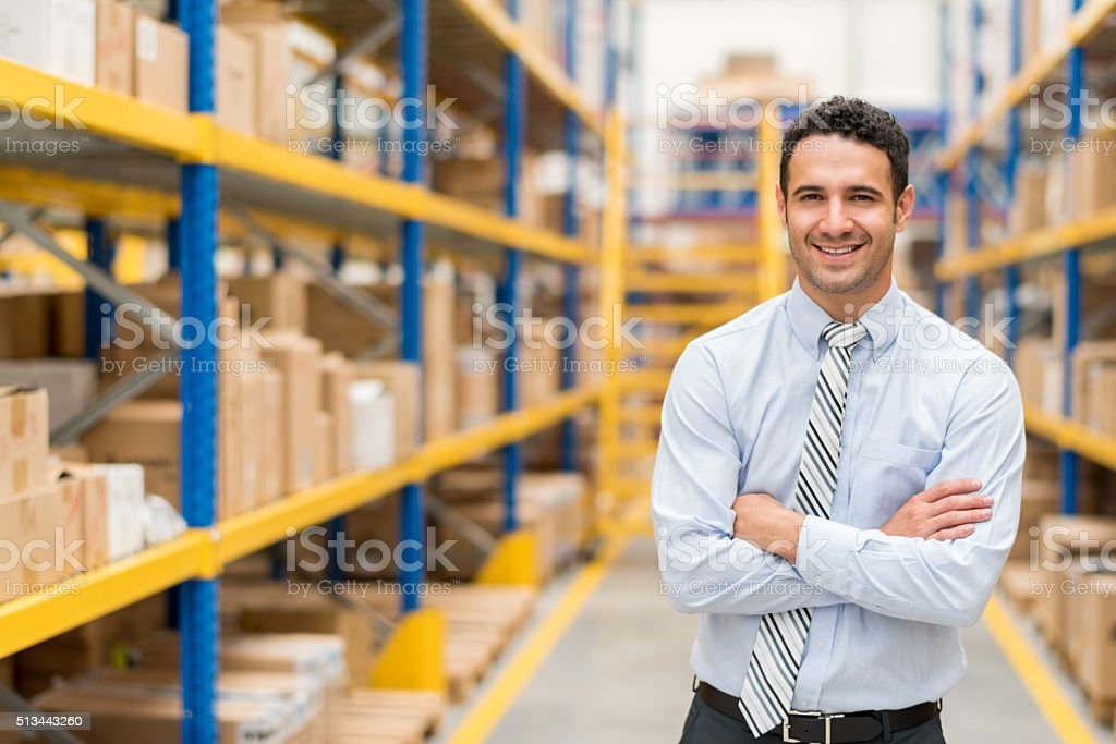 Business man in a warehouse stock photo