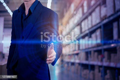 Business man in blue suit  with digital technology virtual reality