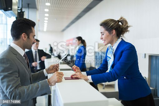 Business man in check-in counter with boarding pass.