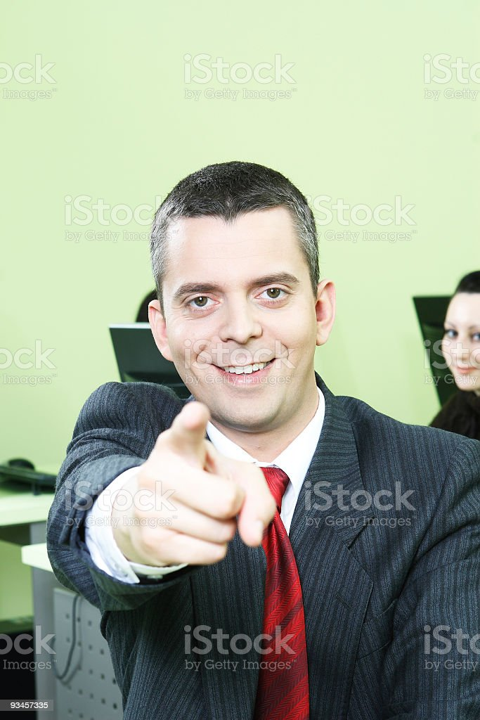 Business Man in Computer Room making I want You gesture stock photo