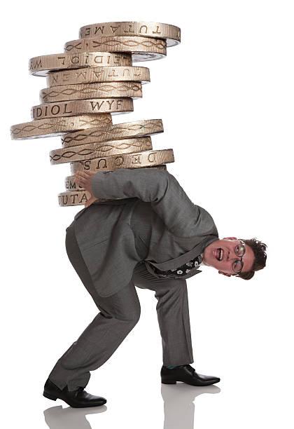 Business man in financial debt struggle stock photo