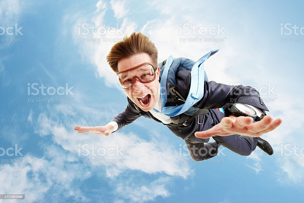 A business man in free fall before the chute opens  stock photo