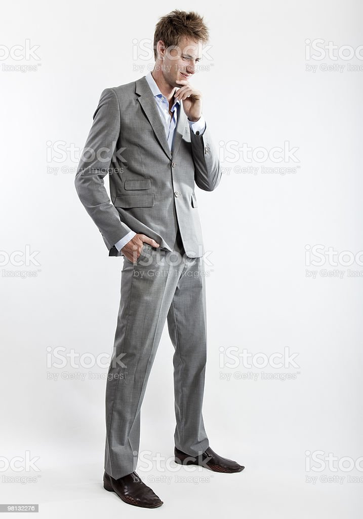 business man in grey suit on white background i royalty-free stock photo