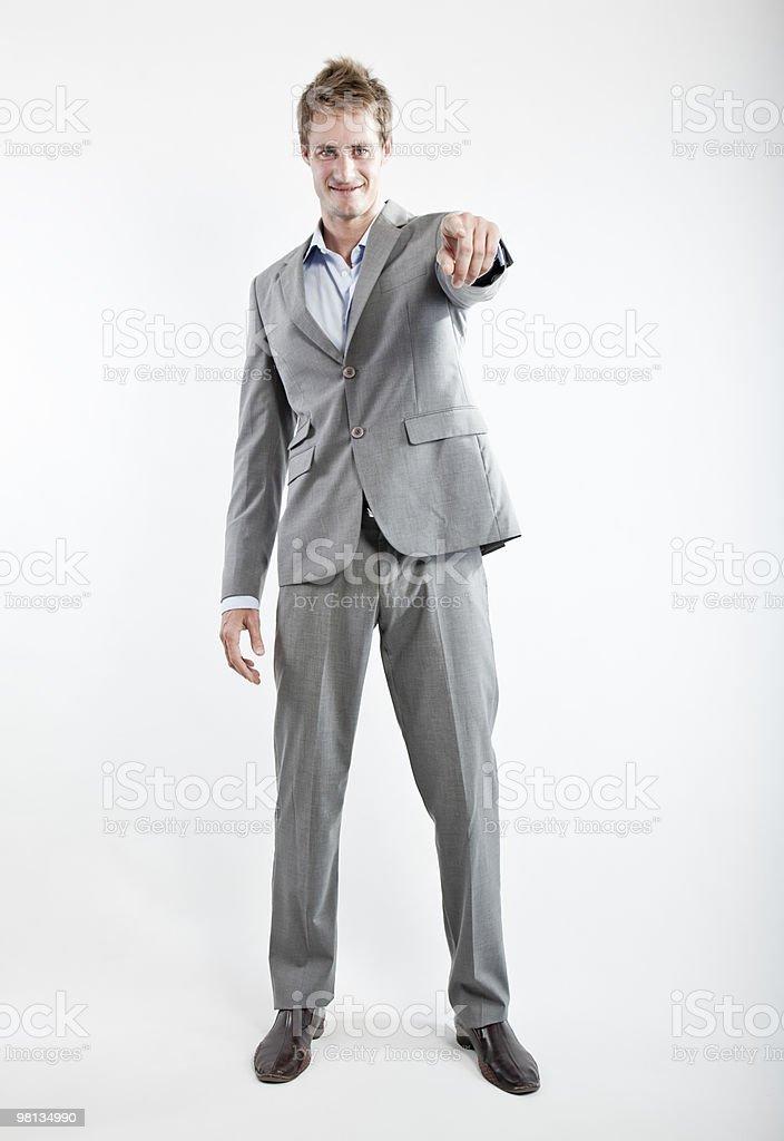 Uomo d'affari in abito grigio su sfondo bianco foto stock royalty-free