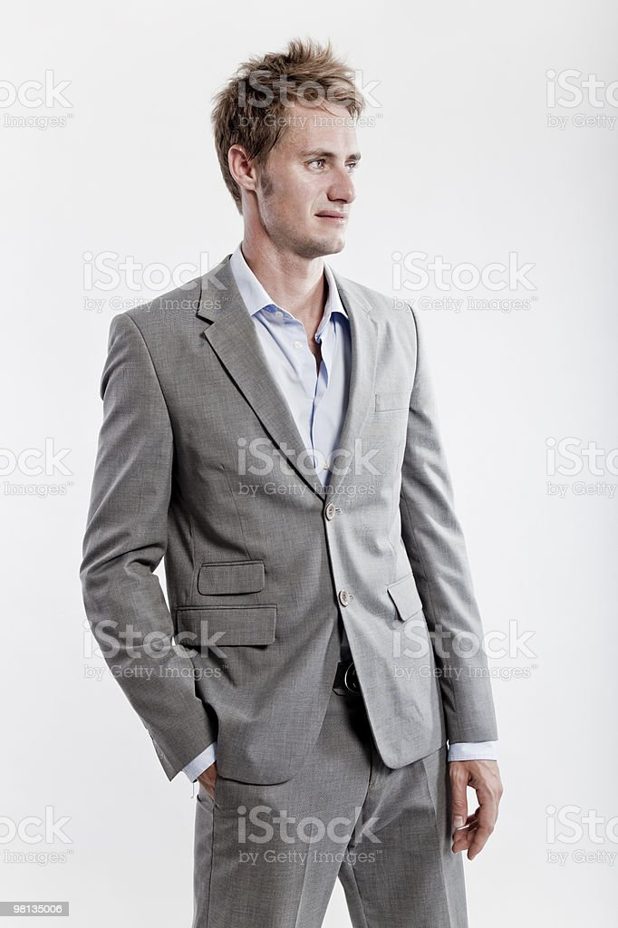 business man in grey suit on white studio background royalty-free stock photo