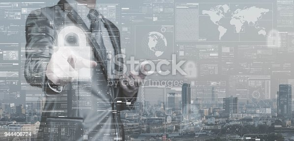 917307226istockphoto Business man in grey suit point on lock icon, data security concept, big data management conceptual 944406724
