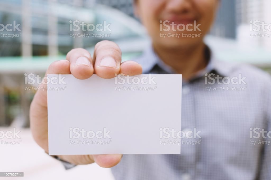 business man in hand hold show blank white card mock up with rounded...