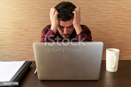 833210686 istock photo Business man in office business man having problem at work 1062567696