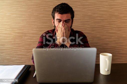 833210686 istock photo Business man in office business man having problem at work 1062569874
