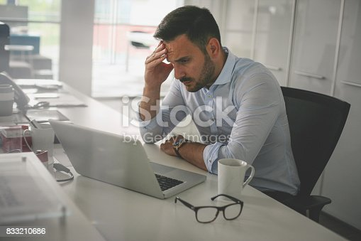 833210686 istock photo .Business man in office. Business man having problem at work. 833210686