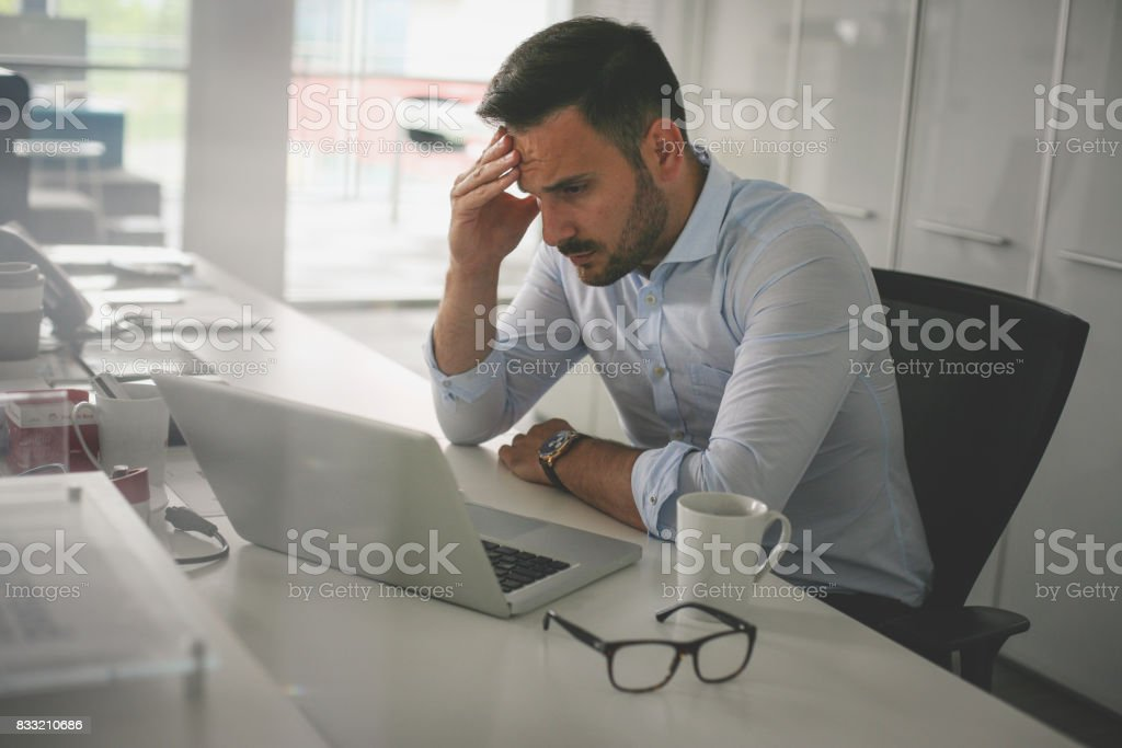 .Business man in office. Business man having problem at work. stock photo