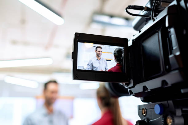 business man in office talking and smiling during corporate interview - filming stock pictures, royalty-free photos & images