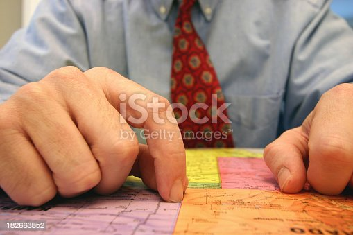 a businessman looking at a map