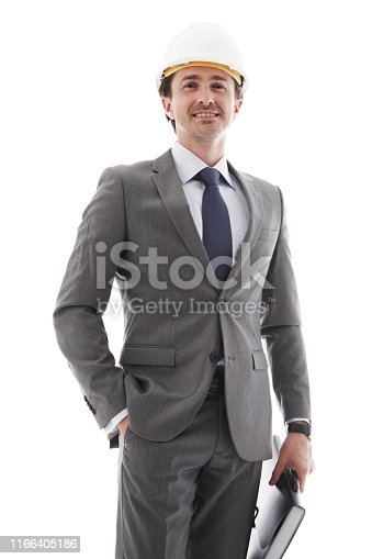 Young businessman in suit and hardhat isolated on white background
