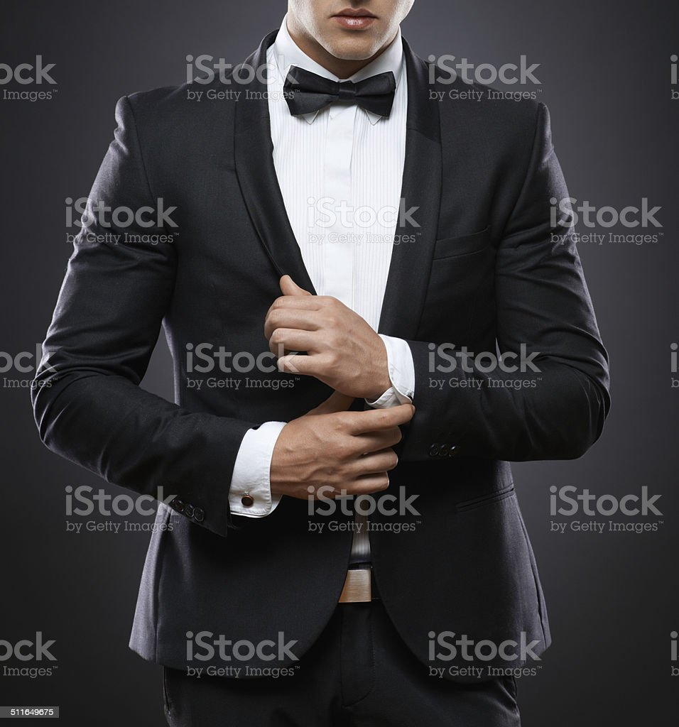 business man in suit on a dark background stock photo