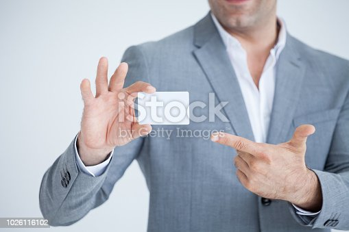 844190384 istock photo business man in Suits show or holding and pointing finger to blank white credit card mockup  isolated on white background with clipping path of card 1026116102