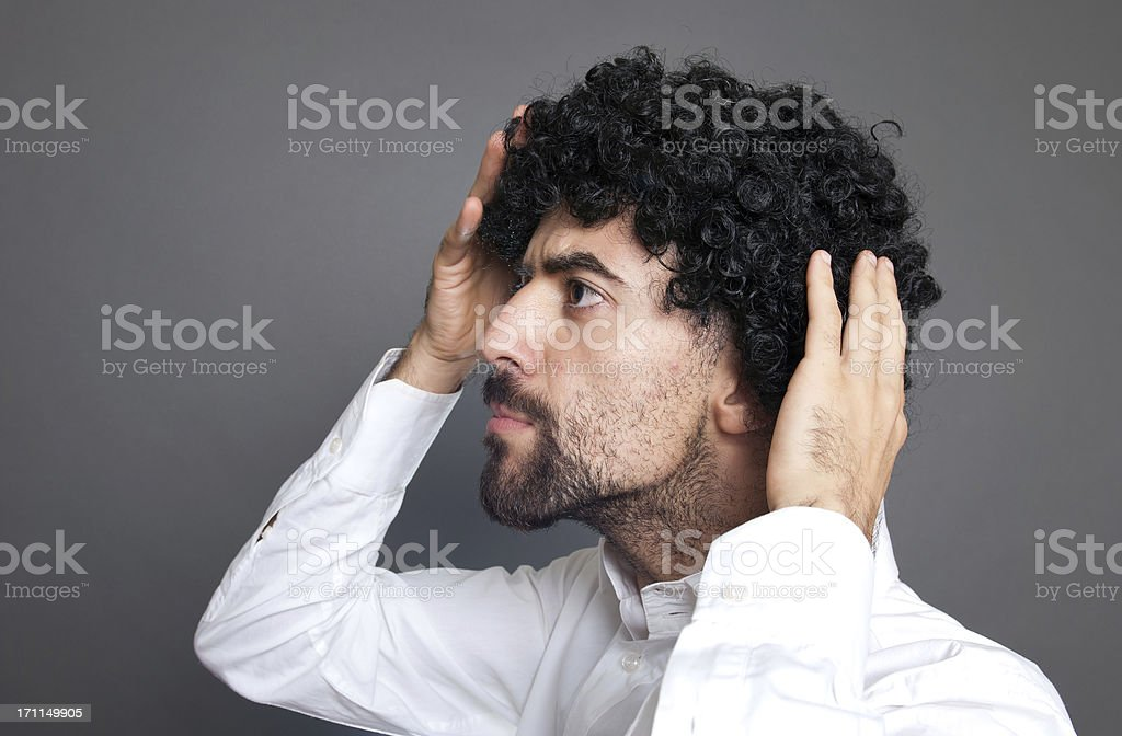 Business Man Inspecting Receding Hairline Baldness on Gray royalty-free stock photo
