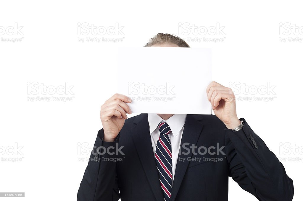 business man is hiding behind a white paper royalty-free stock photo