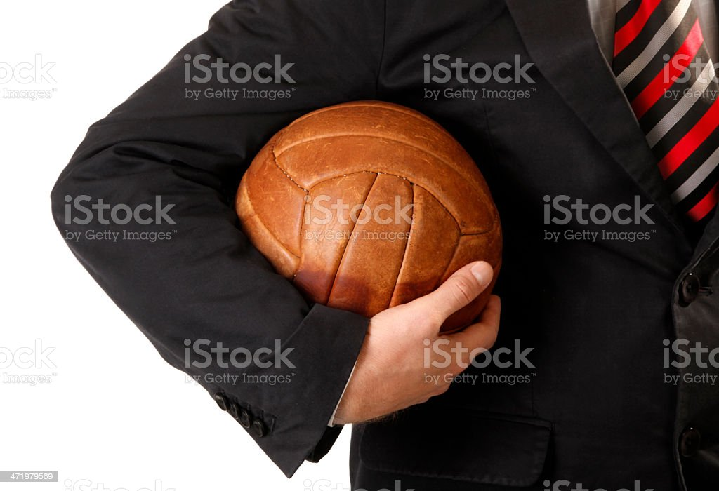 Business man is holding ball for soccer or football royalty-free stock photo
