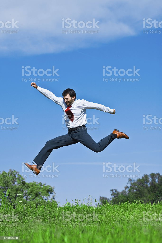 business man jumping freedom royalty-free stock photo