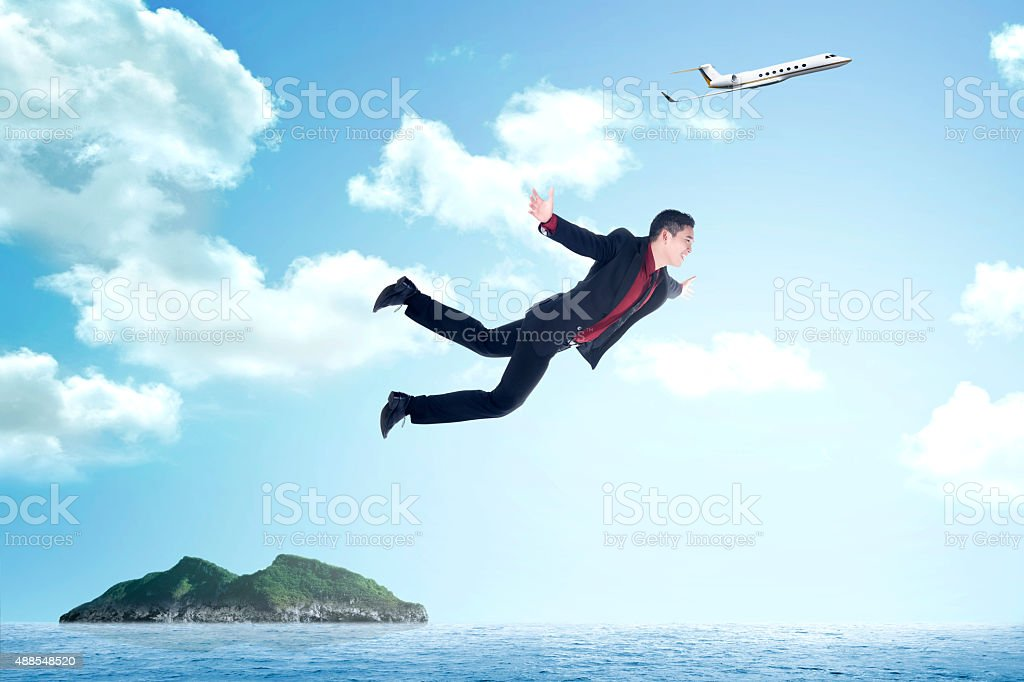 Business man jumping from airplane stock photo