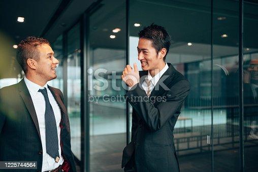 647200468 istock photo business man laughing during the meeting 1225744564