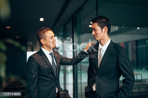 647200468 istock photo business man laughing during the meeting 1225744634