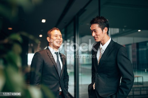 647200468 istock photo business man laughing during the meeting 1225745696