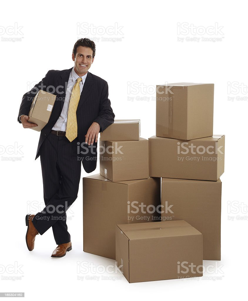 Business Man Leaning on Some Boxes royalty-free stock photo