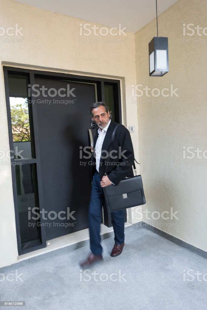 Business Man Leaving Home For Work Stock Photo & More Pictures of 50 ...