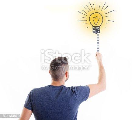 istock business man lights a bulb idea 504133570