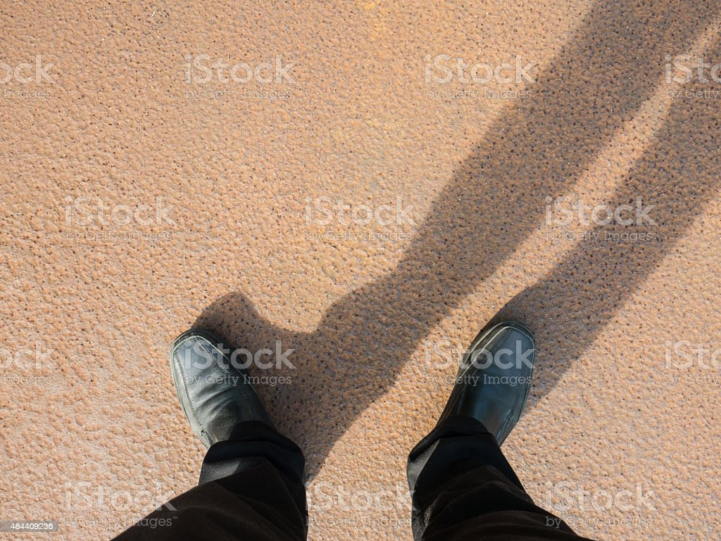 Business man look down to floor, full of rust. stock photo