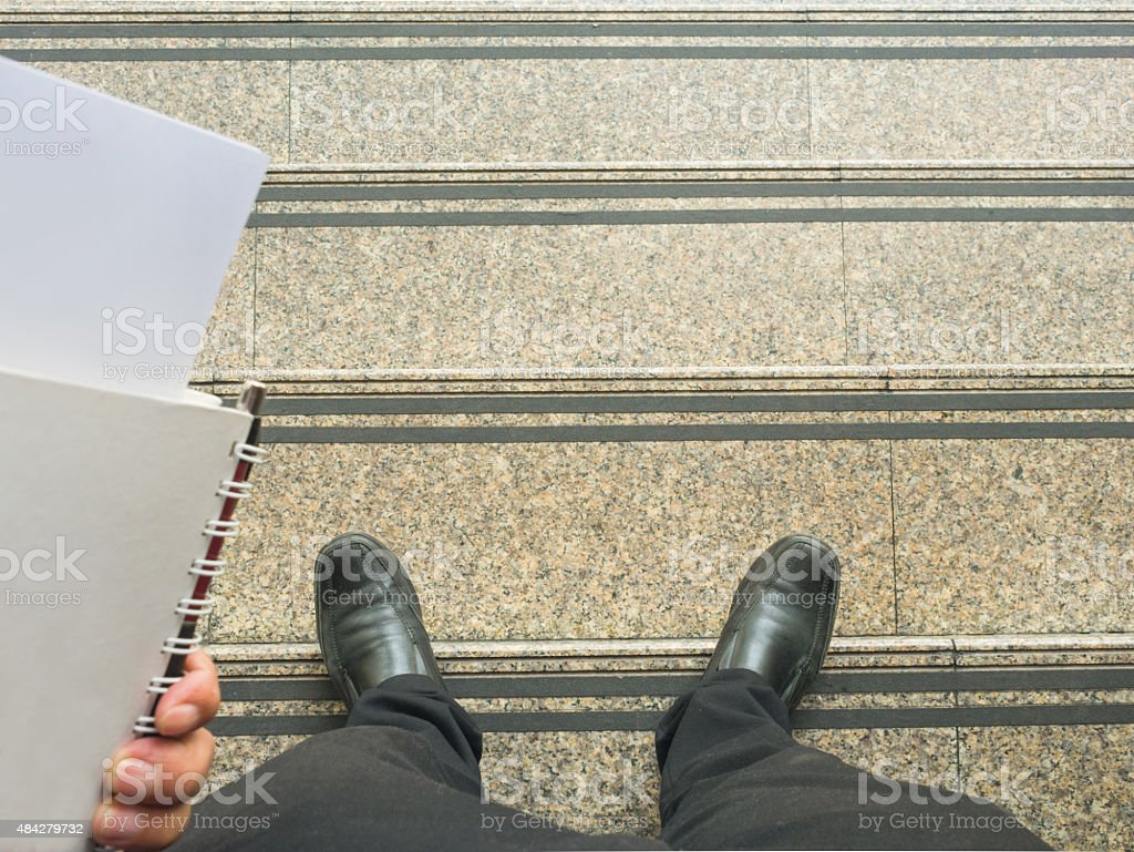 Business man look down to stair. stock photo
