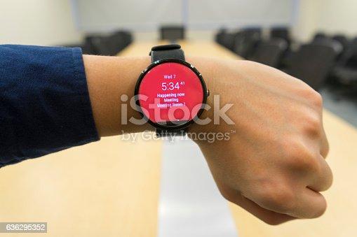 831622420 istock photo business man look smartwatch at meeting room show agenda schedule 636295352