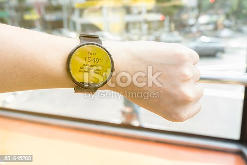 istock business man look smartwatch for checking time to meeting 831645208